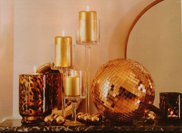 Animal Print and Stem glasses with gold metallic candles in Elle Decor