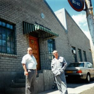 Father and Son outside candle factory in Woodstock